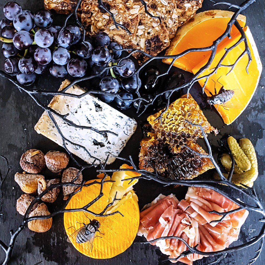 Looking for a touch of the dramatic this October? Use these tips and tricks to put together a deceivingly creepy Halloween Cheese Board, and impress your guests with a macabre twist on a crowd-pleasing classic. | FeastInThyme.com