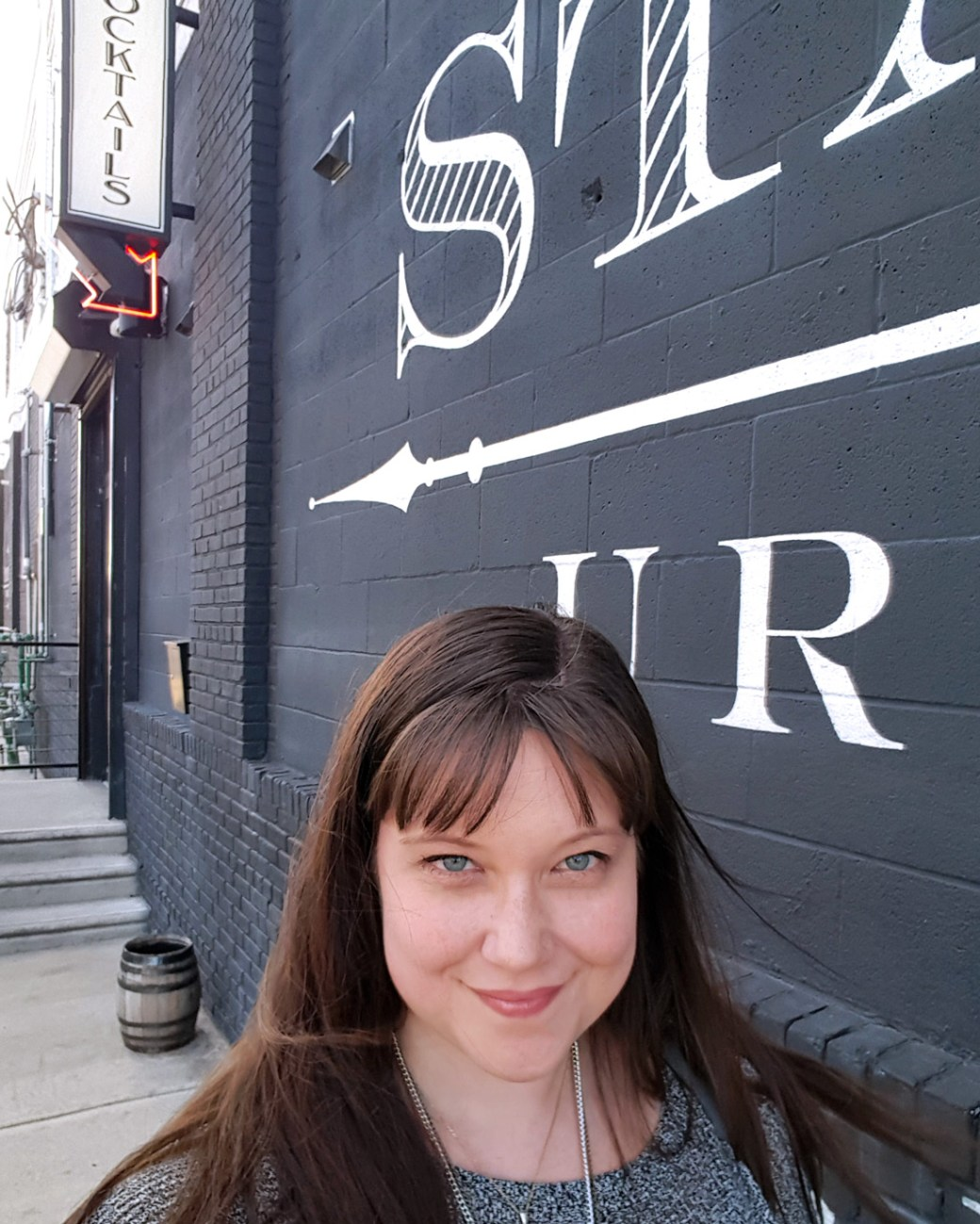 A selfie of me in front of the distillery for Stateside Urbancraft Vodka. | Thymeline 35: Celebrating Philly Craft Spirits | FeastInThyme.com