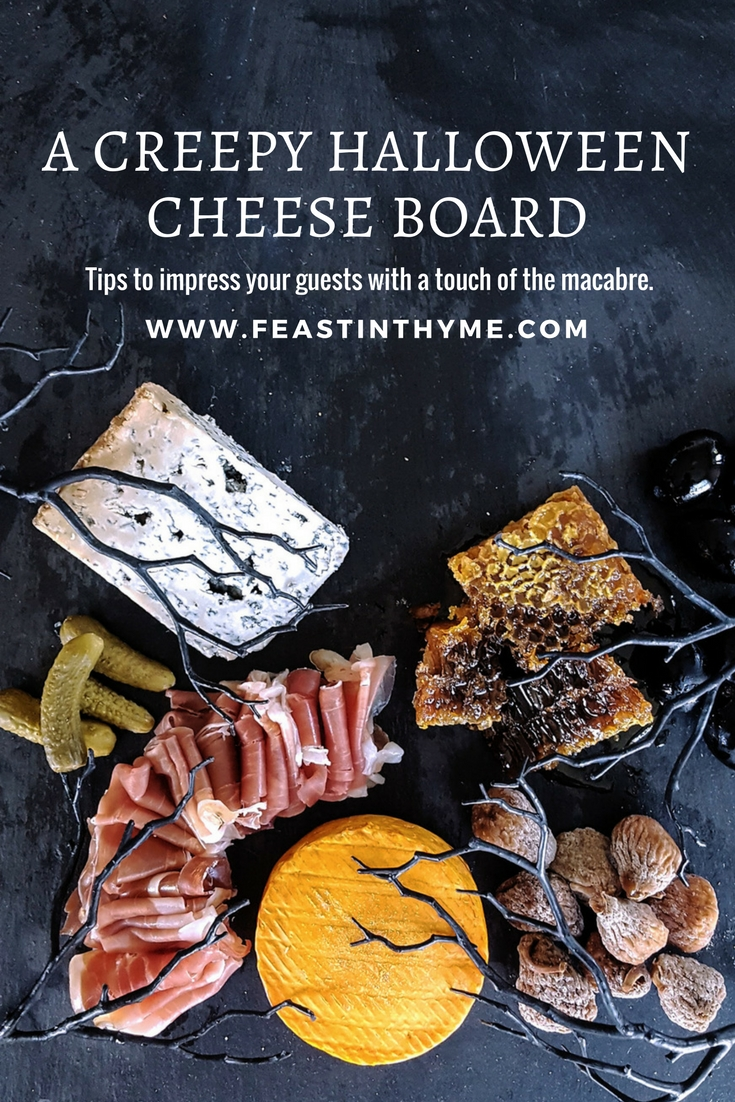 Looking for a touch of the dramatic this October? Use these tips and tricks to put together a deceptively creepy Halloween Cheese Board, and impress your guests with a macabre twist on a crowd-pleasing classic. #Halloween #cheese #cheeseboard | FeastInThyme.com