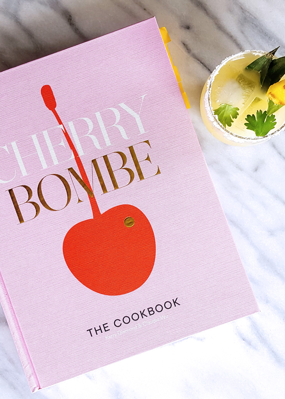 A review of Cherry Bombe: The Cookbook – a celebration of influential women in the food industry and beautiful food through a collection of artfully photographed recipes and personal stories. | FeastInThyme.com #cookbookreview #cherrybombe