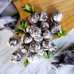 One bite of these Double Mint Chocolate Chip Crinkle Cookies and you'll be in love! They are just the right balance of sweet mint and fudgy dark chocolate. #cookies #mintchocolate #sweets | FeastInThyme.com