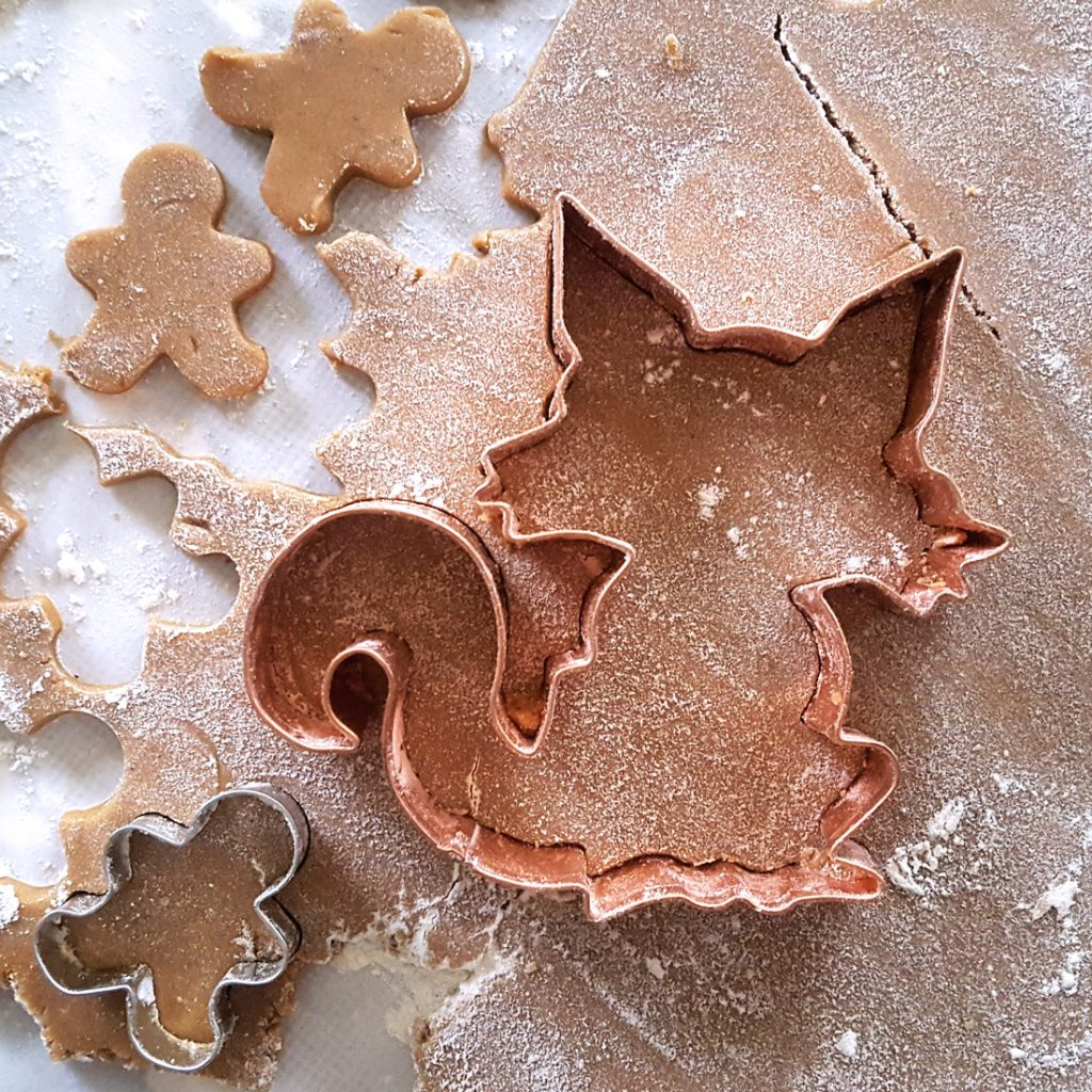Cutting out gingerbread for the holidays. | FeastInThyme.com