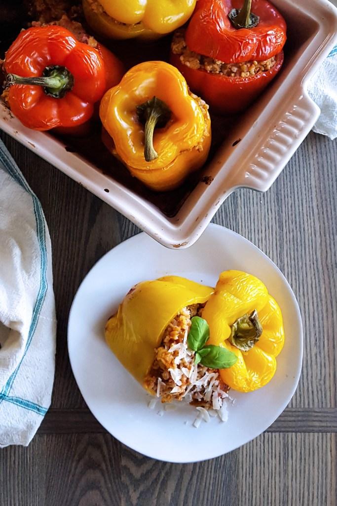 A serving of easy stuffed bell pepper alongside the full casserole dish.