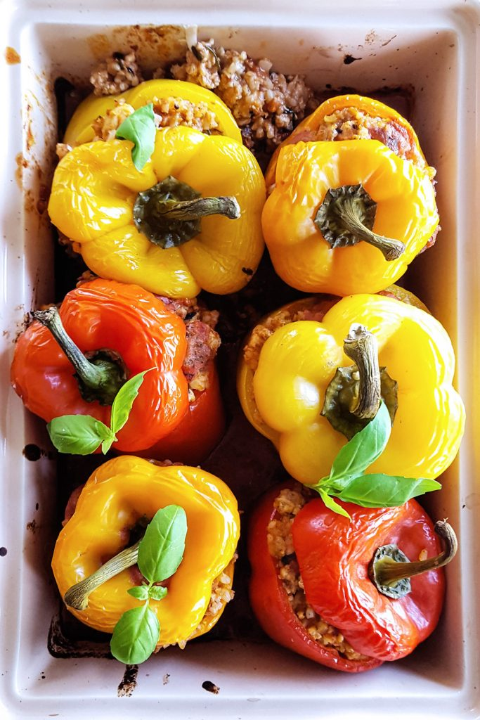 Making these Stuffed Bell Peppers with a filling of brown rice, creamy tomato sauce, fennel, and spices is easy enough for a #weeknightmeal or to #makeahead for a delicious lunch. Best of all, they are #LowFODMAP, #LowLactose, and naturally #GlutenFree! #mealplan #dinnertime | FeastInThyme.com