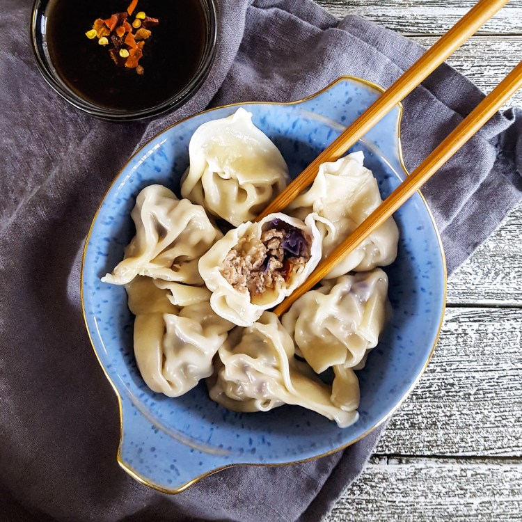 Traditional flavors and an #easyrecipe make these Simple Pork & Mushroom Dumplings a delicious way to enjoy #DimSum at home. Make them ahead for a quick #weeknightmeal when you need it! #dumpling #homemade #makeahead #mealplanning   FeastInThyme.com