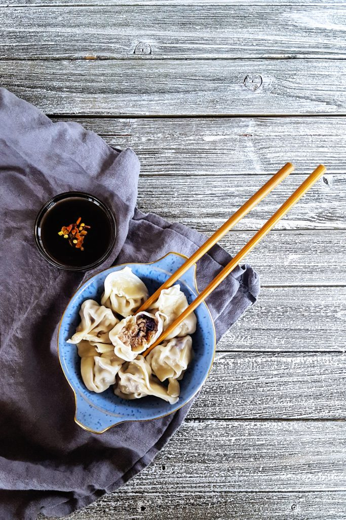 Simple Pork & Mushroom Dumplings with one cut open.