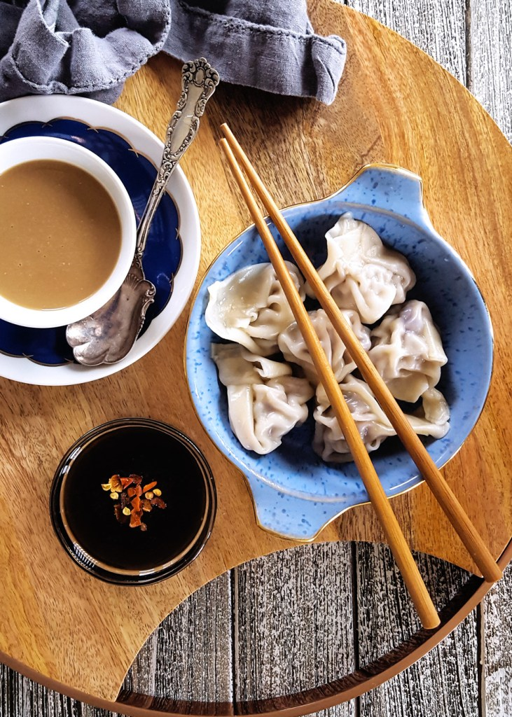 Simple Pork & Mushroom Dumplings in a blue ramekin with chopsticks, soy sauce, and a cup of coffee.