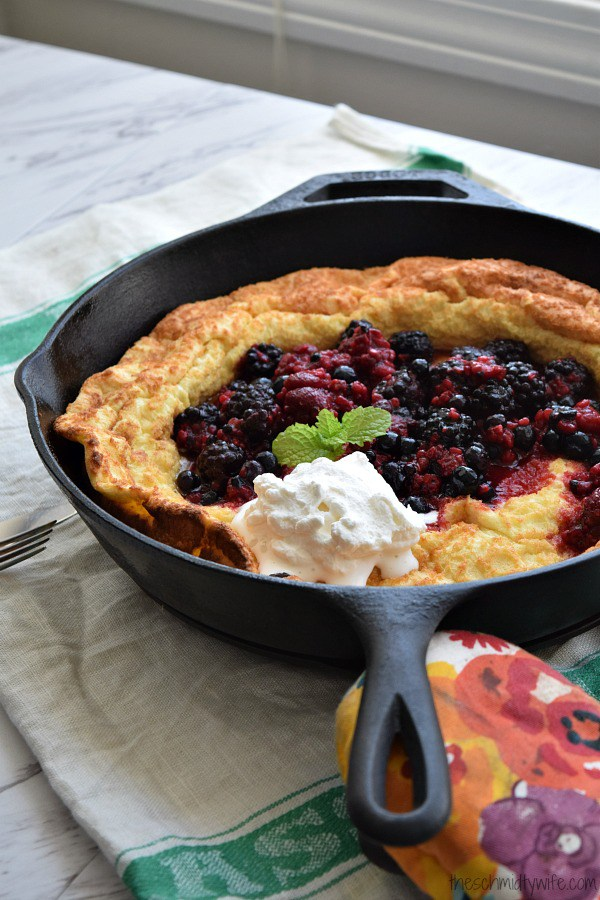 Lemon Dutch Baby with Berry Compote and Whipped Cream from The Schmidty Wife