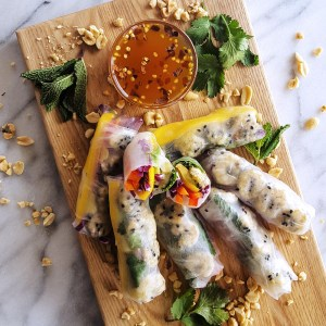 Packed with ripe mango, creamy avocado, and a rainbow of vegetables and herbs, these Sesame Lime Roasted Shrimp Summer Rolls are a #quick and #healthy meal option perfect for any day of the week. #easyrecipe #summerroll #shrimp   FeastInThyme.com