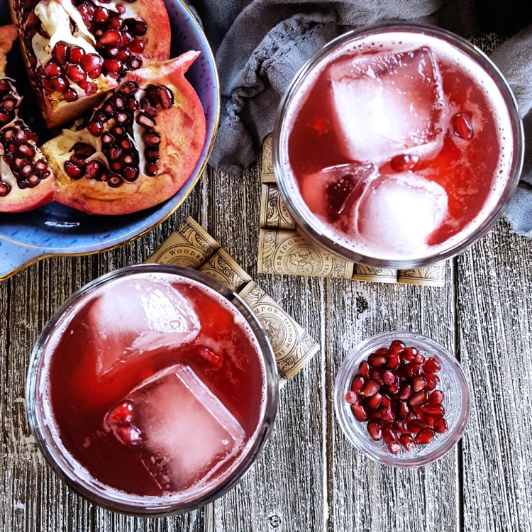 With #homemade lemon simple syrup, the Forbidden Flower Sour is a potent and refreshing elderflower & pomegranate bourbon cocktail, ideal for relaxing after a long day or sharing on the porch with friends. #cocktailrecipe #pomegranate #bourbon #whiskey #elderflower | FeastInThyme.com