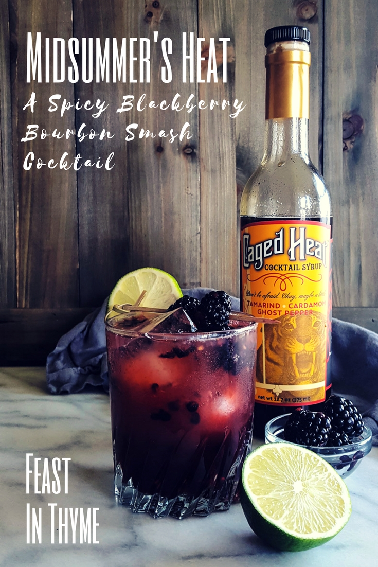 Midsummer's Heat is a Spicy Blackberry Bourbon Smash Cocktail made with fresh fruit, tart lime juice, and the award-winning Caged Heat Cocktail Syrup! #cocktails #craftcocktails #mixology #homebar #entertaining #signaturedrink | FeastInThyme.com