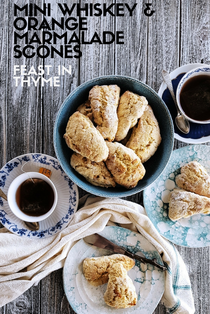 Homemade Mini Orange Scones are made extra special with a heaping spoonful of marmalade and a dash of whiskey. Bake up a batch with a side of tea, jam, and lemon curd. Brunch never tasted so good! #brunch #teatime #picnic #scones #baking | FeastInThyme.com