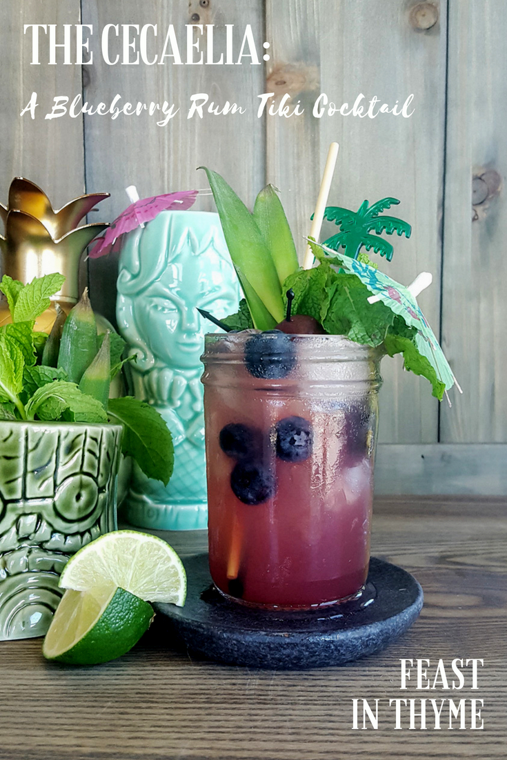 Named after the mythic sea witch, the Cecaelia is a dangerously potent blueberry rum tiki cocktail full of fresh juices and warm island spices. #tikiweird #tikicocktail #tikitime #blueberry #rum | FeastInThyme.com