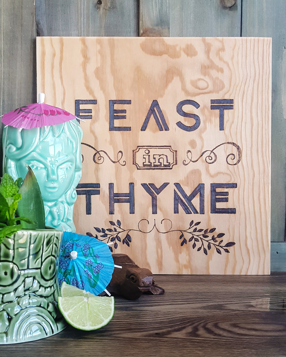 Feast In Thyme Sign with Tiki Bar