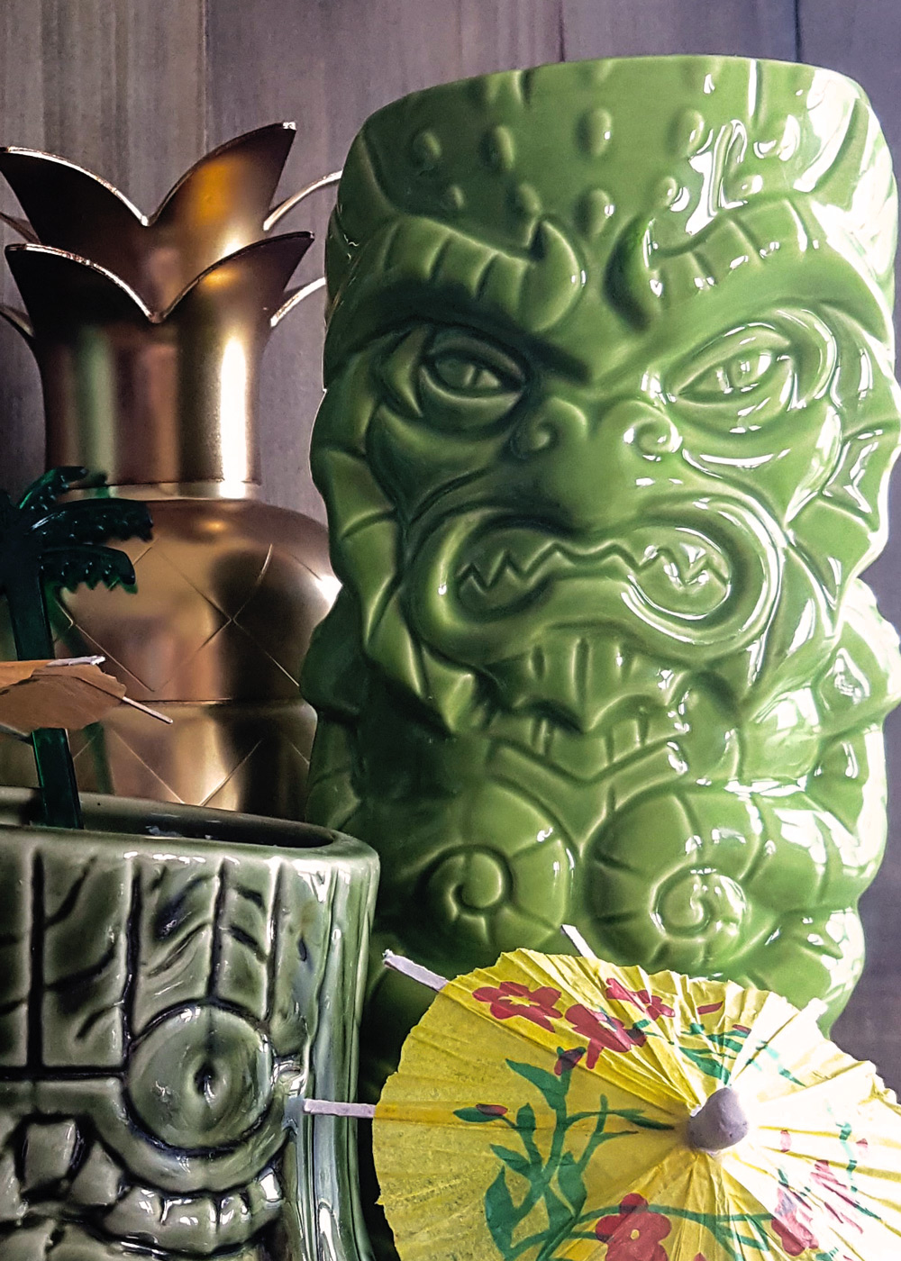 A close-up of a ceramic tiki mug in the shape of a kraken.