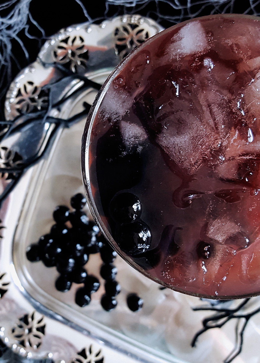 Under the Scarlet Sea | An Earl Grey Bourbon Pomegranate Punch