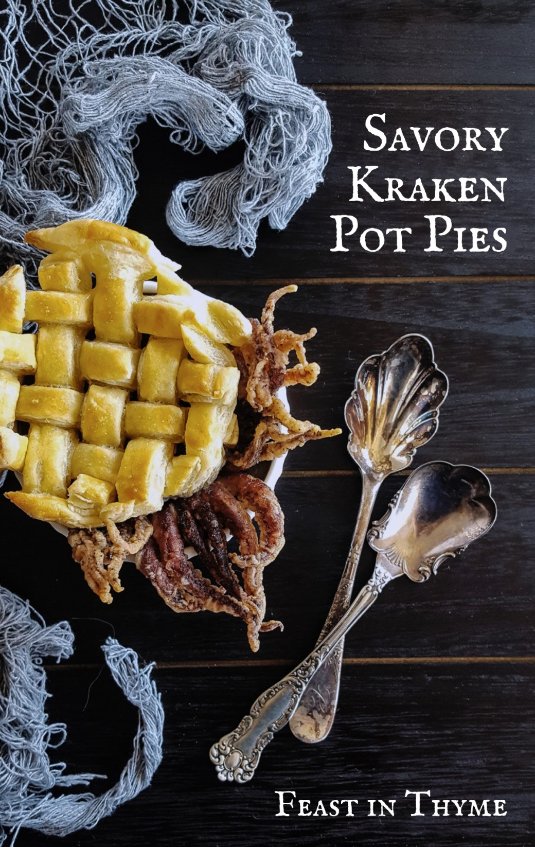 Sweet & Creamy Crab & Calamari Seafood Bisque get dressed up for Halloween as Savory Kraken Pot Pies! With black squid ink, lightly fried tentacles, and a buttery pastry top, it's easy to believe these little horrors come straight from the deep seas. #seamonster #kraken #potpie #halloween | FeastInThyme.com