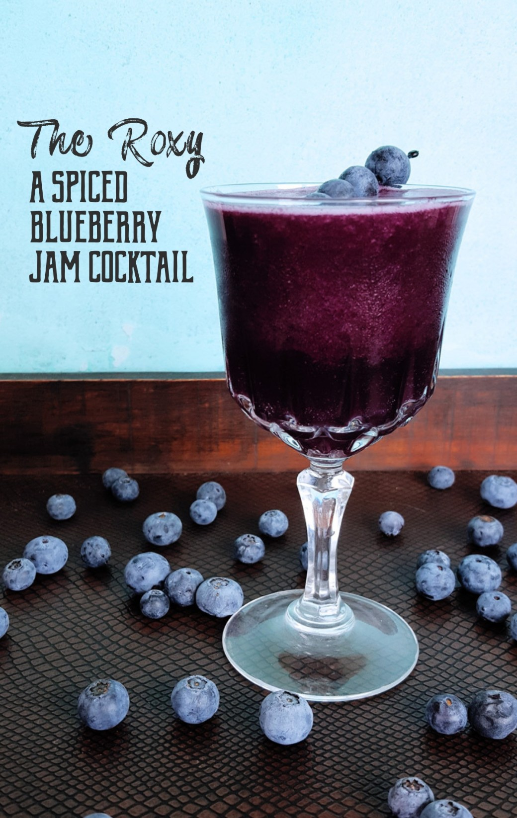 With warm spices, sweet berries, and tropical juices, this Spiced Blueberry Jam Cocktail a vibrant purple delight to the senses. #berries #cocktail #rum | FeastInThyme.com