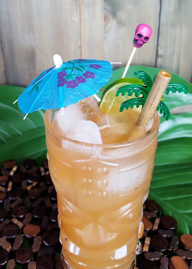 Overhead image of a Zombie Punch with garnishes.