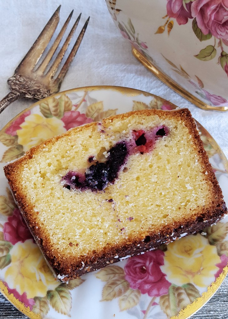 One slice of Harken Cake on plate of flowery china.