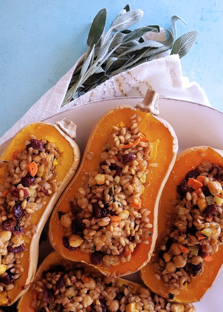Overhead view of a plate of farro stuffed butternut squash.