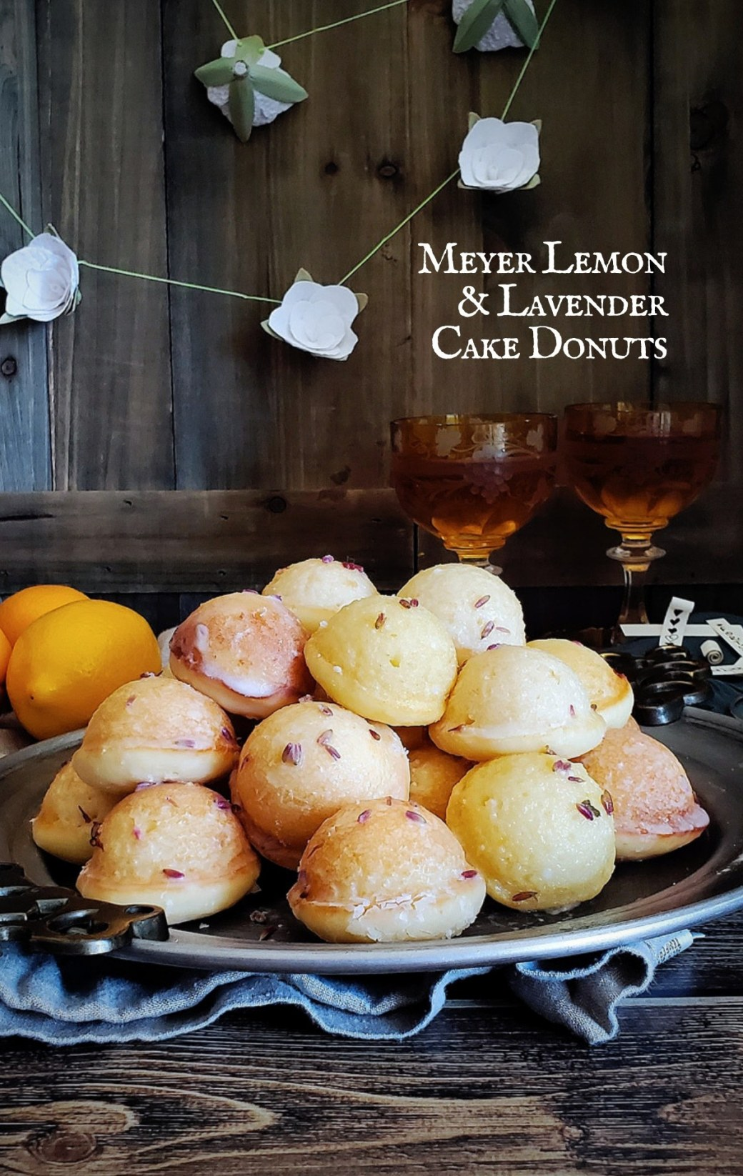 Full of citrus zest and coated in sugary glaze, these Meyer Lemon Lavender Cake Donuts are a bright and beautiful treat. #donut #baking #lemon #teaparty | FeastInThyme.com