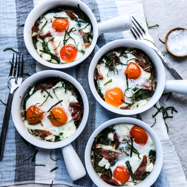baked eggs with spinach, maitake, prosciutto, and goat cheese // feastofgreen.com