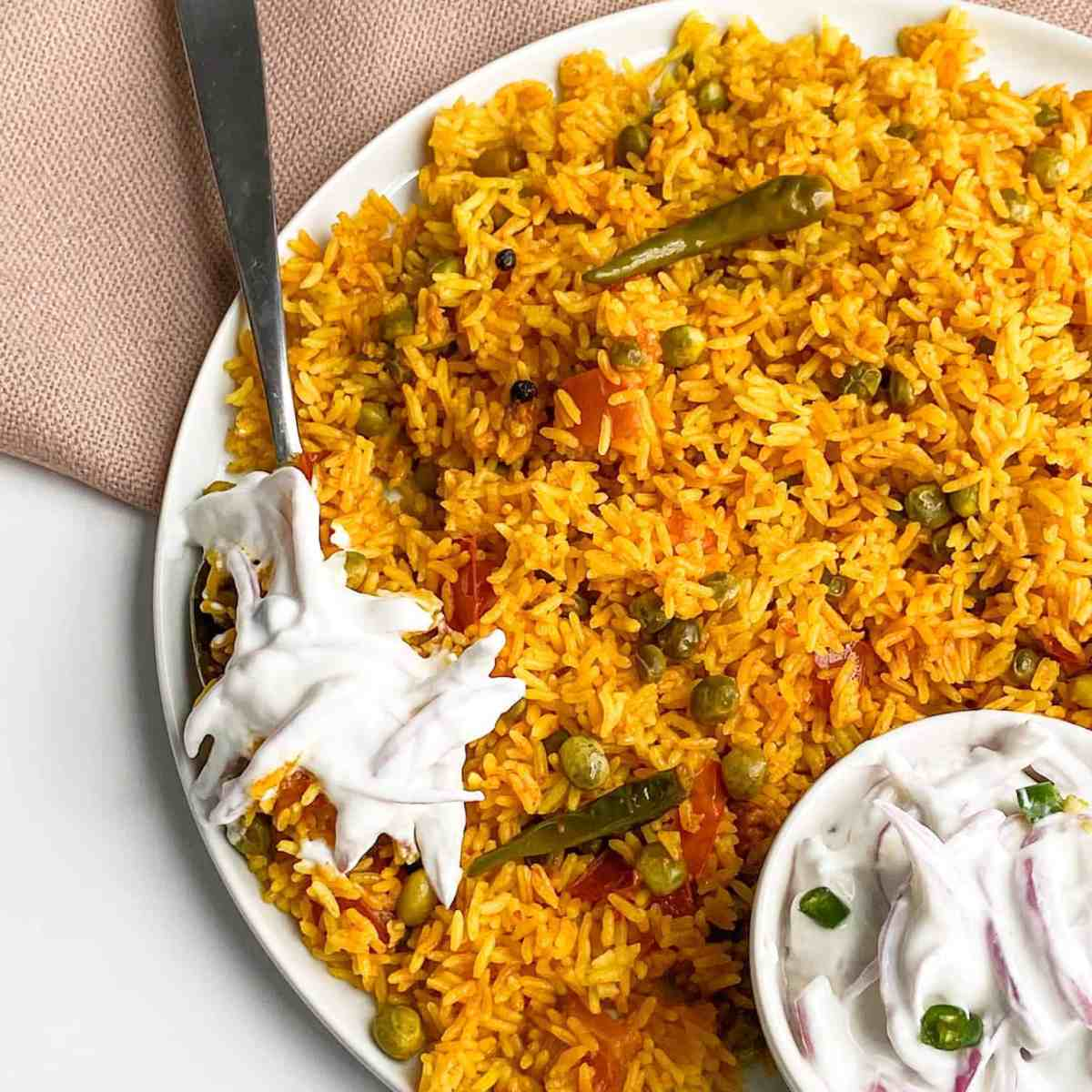 one-pot vegetable spicy rice with yogurt sauce.