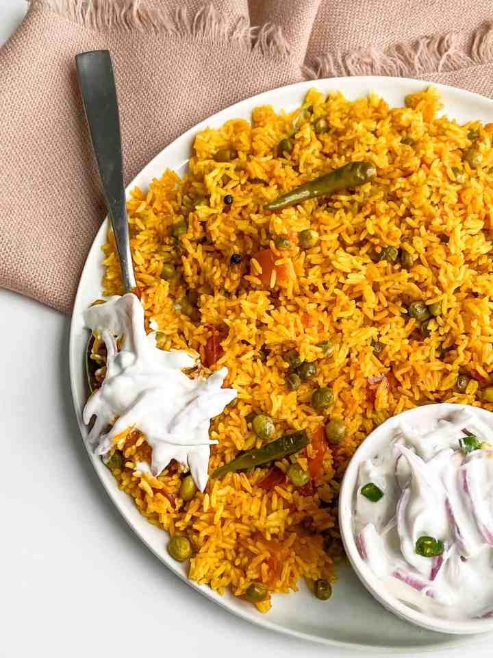 Vaghareli Khichdi-spicy rice with yogurt sauce.