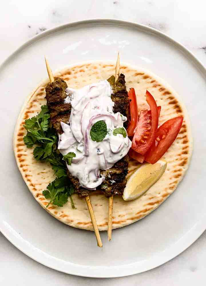 Kebab and pita sandwich with onion raita.