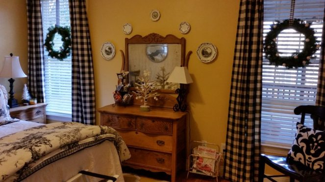 Guestroom with funny little felt tree and plaid beribboned wreathes.