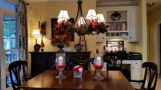 Kitchen table with garland swagged chandelier.