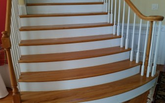 Orange stairs and banister prior to refinishing