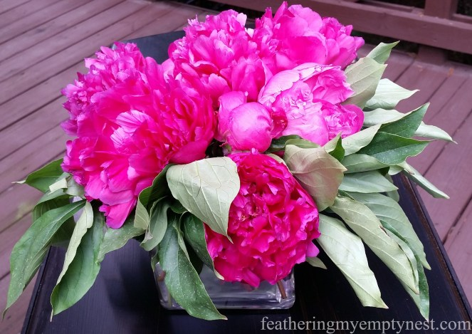 Pink peonies decorate the serving table in a Romantic Flower-themed Summer Tablescape