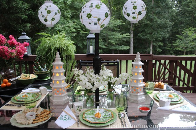 Embellished paper and ceramic pagoda lanterns illuminate Dim Sum On The Deck: A Chinese Takeout Dinner Party---featheringmyemptynest.com