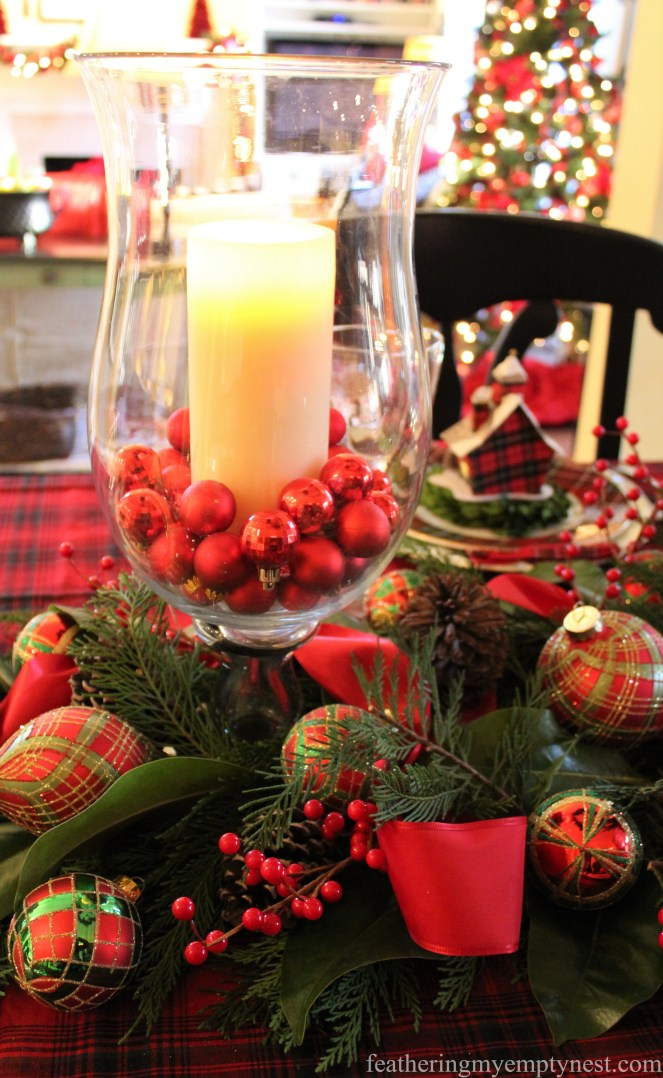 Hurricane with white pillar candle and Christmas balls --Pancakes & Plaid: A Christmas Breakfast Table