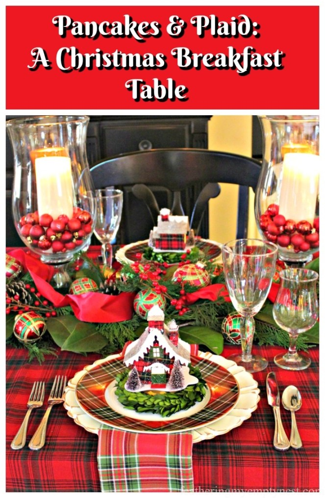 A Christmas Breakfast Table decorated with red and green plaid tablecloth, plates, ornaments, and a greenery runner and a recipe for Oatmeal Pecan Pancakes--Feathering My Empty Nest