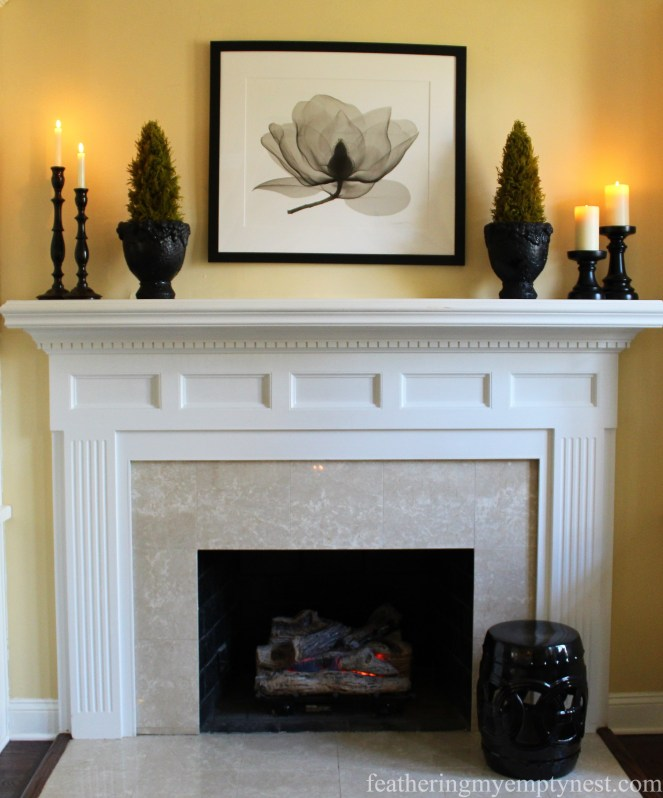 Black and white elements create a classic look for the mantel --Why My Family Room Decor Is Always A Work In Progress