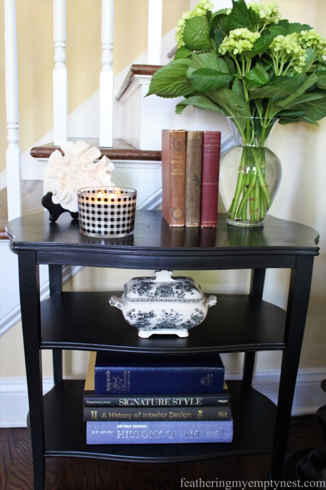 Small three-shelf side table provides an opportunity to display accessories and add interest to this corner of the room --Why My Family Room Decor Is Always A Work In Progress