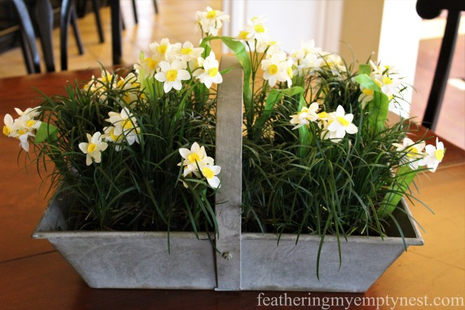 """Faux Narcissus """"grow as if naturalized in live Mondo Grass --Faux Narcissus are planted in live Mondo Grass for a convincing Spring display"""