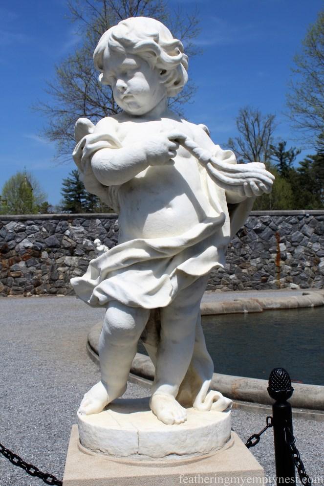 Statue of a cherub in the Italian Garden of the Biltmore Estate in Asheville, NC --A Spring Tour Of The Biltmore Estate Gardens
