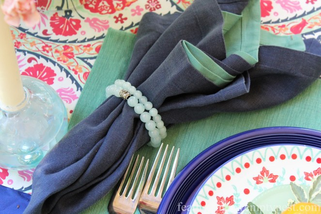 Beaded bracelets make a lovely napkin ring on An Impromptu Outdoor Table For Two