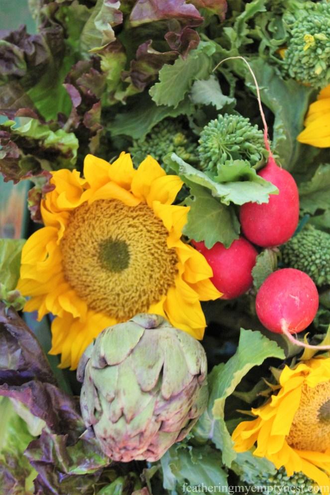 Closeup of sunflowers and veggie arrangement --Fall Harvest Tablescape