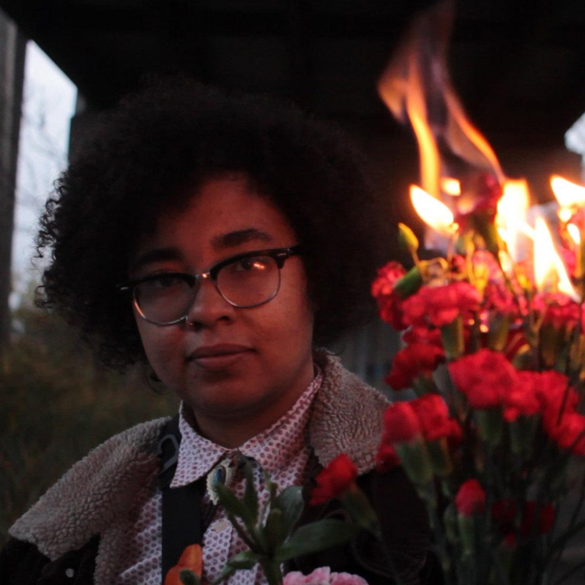 Singer of Rest Ashore Burning Roses Up Close