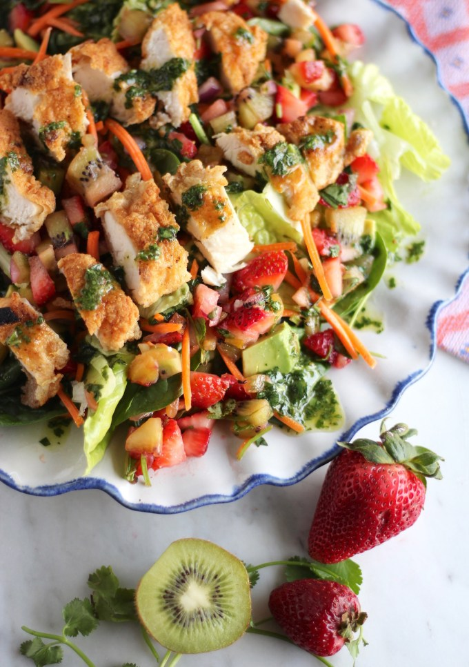 Strawberry Kiwi Salad with Crispy Chicken and Cilantro Vinaigrette - this salad is AWESOME and full of fruit, tender chicken, and tangy dressing! | fedandfulfilled.com