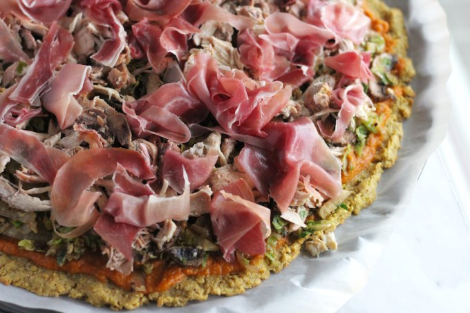Turkey Cranberry Prosciutto Pizza (AIP, Paleo) - this pizza takes on sweet flavors of cranberry sauce and pumpkin with savory prosciutto, turkey, and brussels sprouts for a delicious combination! | fedandfulfilled.com