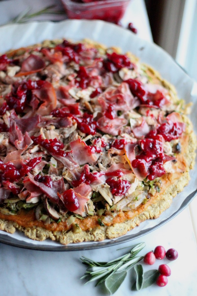 Turkey Cranberry Prosciutto Pizza (AIP, Paleo) - leftover holiday turkey and cranberry sauce are combined with brussels sprouts, mushrooms, prosciutto, and a creamy pumpkin sage pizza sauce! | fedandfulfilled.com