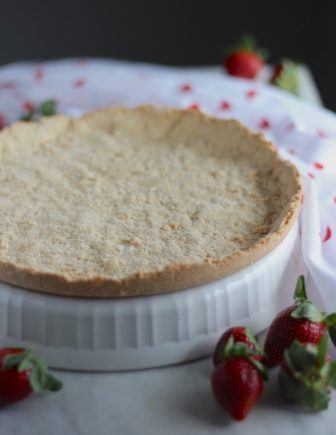 Paleo Strawberries and Cream Tart (AIP, Vegan) - a stunning dairy-free strawberry tart filled with juicy berries and thick coconut cream, all in a crispy coconut cookie crust! Delicious! | fedandfulfilled.com