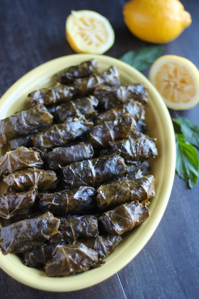 Instant Pot Paleo Stuffed Grape Leaves (AIP) - savory beef and cauliflower rice are combined with sweet golden raisins, cinnamon, and fresh mint to create an incredible main dish or appetizer recipe! | fedandfulfilled.com