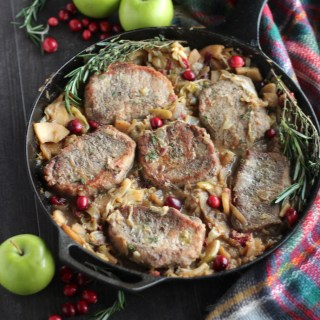 Apple Cranberry Skillet Pork Chops (AIP, Paleo) - a rustic, festive main dish for the holidays, featuring pork, apples, cranberries, and cabbage!   fedandfulfilled.com